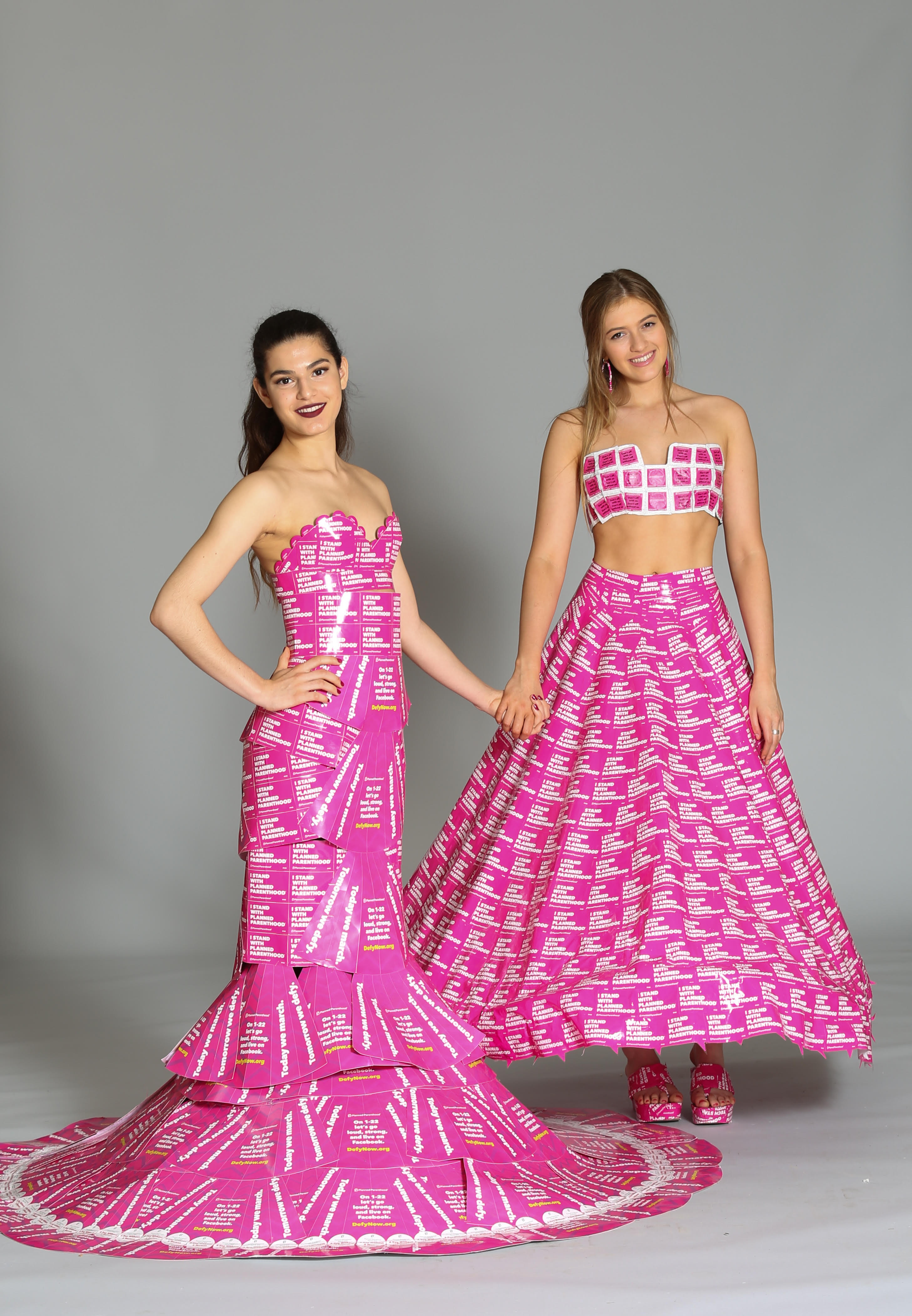 Montes (left) and Belastri (right) created their dresses entirely out of informational materials from Planned Parenthood.