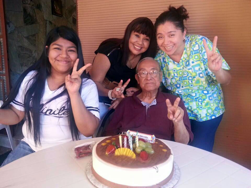 Mena-Reyes' father celebrating his birthday with his family and nurse.