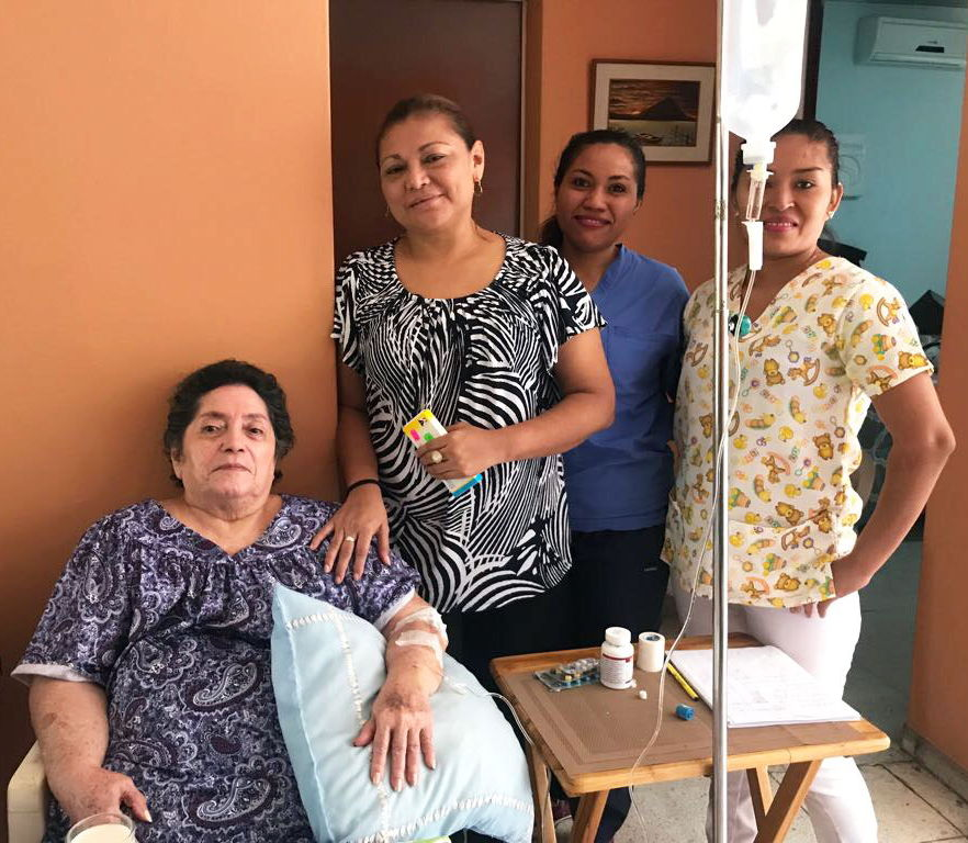 Mena-Reyes' mother with her nurses.