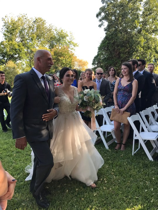 Brielle being walked down the aisle by her dad's best friend Steve.