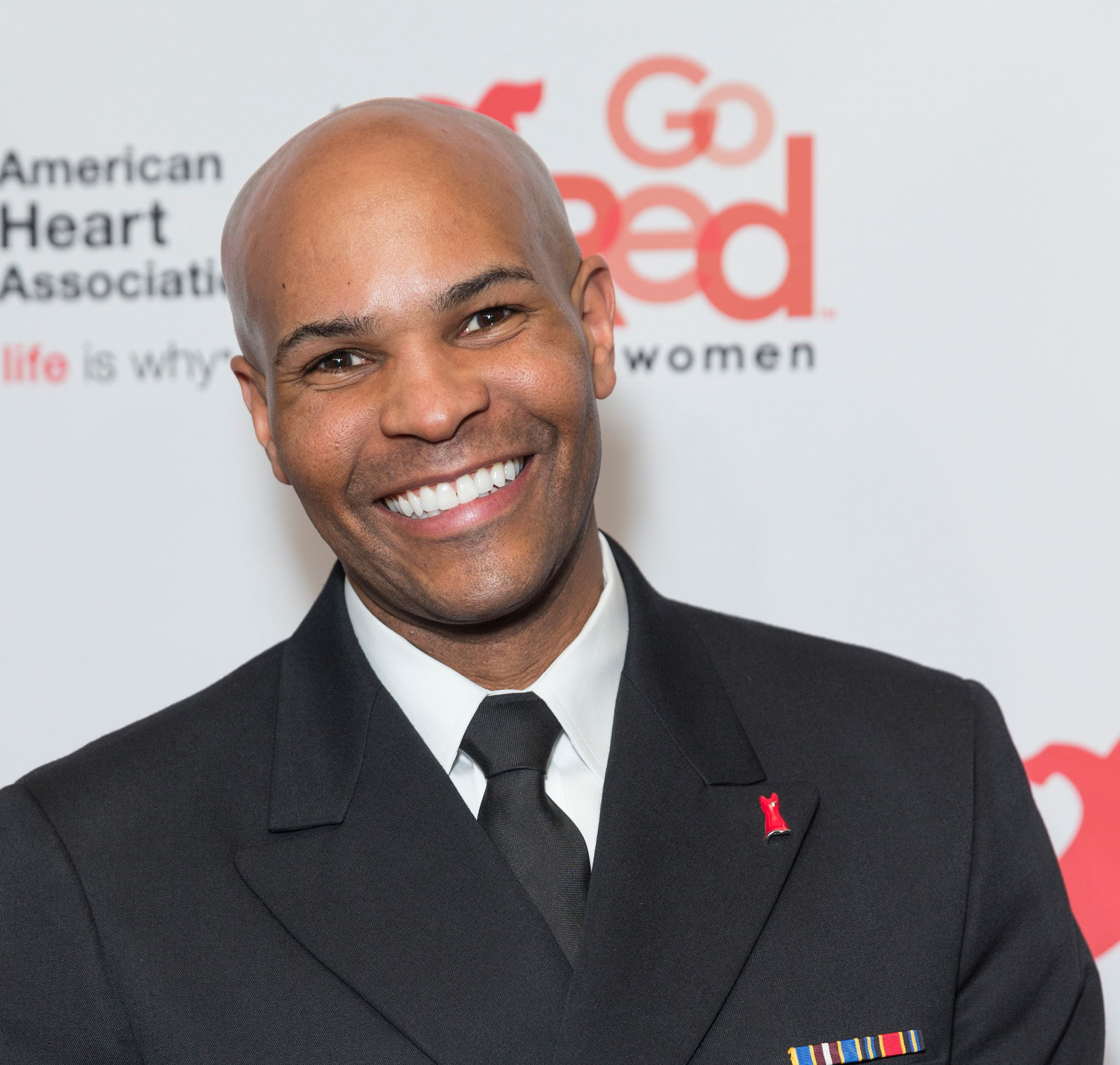 U.S. Surgeon General Dr. Jerome Adams attends show for Red Dress 2018 Collection Fashion Show at Hammerstein Ballroom. lev radin / Shutterstock.com.